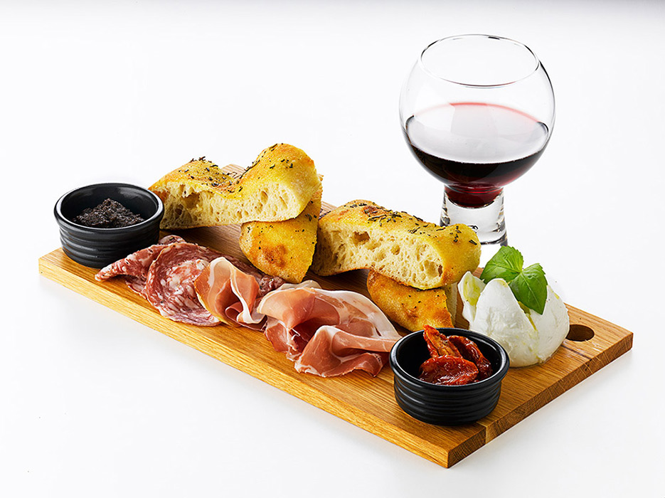 Italian platter on wooden board with wine by London Food Photographer