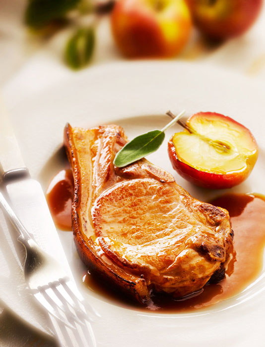 Pork Chop with Roasted apple and Sage by London Food Photographer Michael Michaels