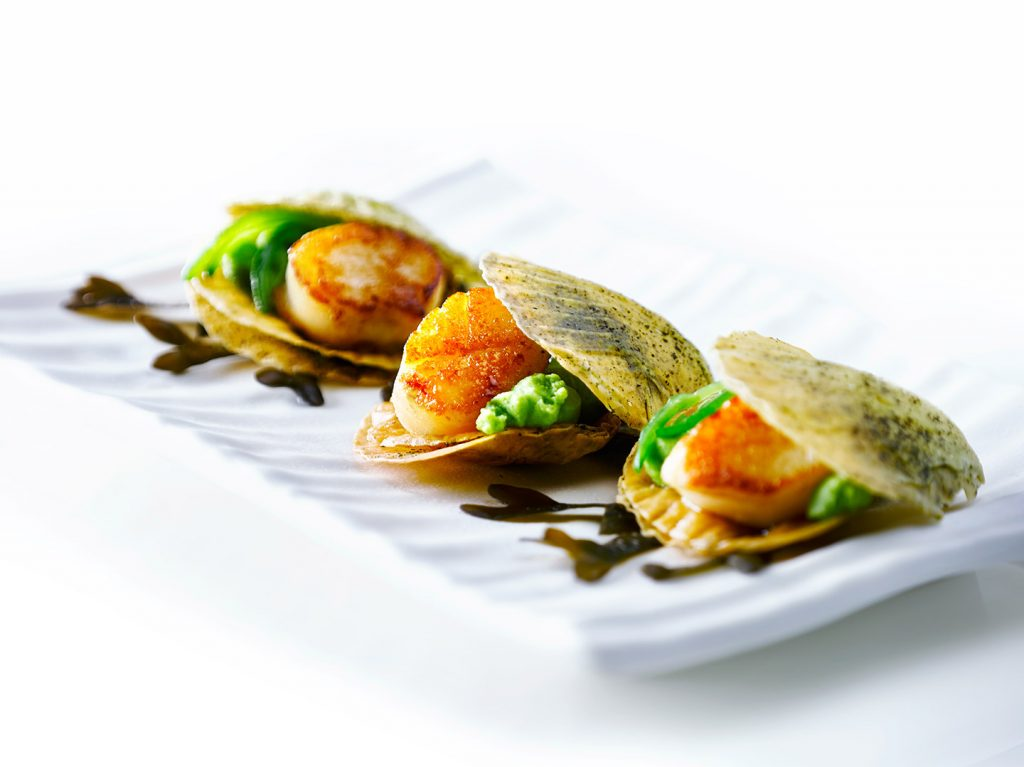 Cooked Scallops on rectangular white dish by London Food Photographer