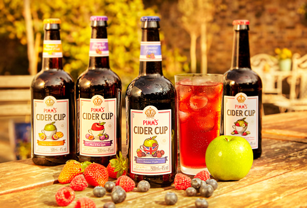 summer style London food and drink photography of Pimms Cider Cup, strawberries, blueberries and raspberries