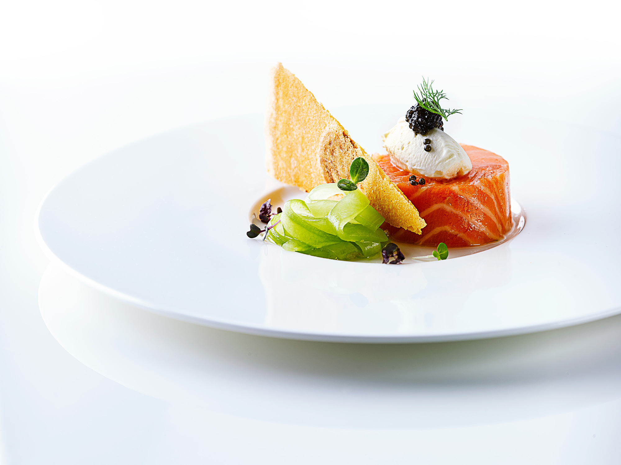 Smoked salmon on white dish by London Food Photographer Michael Mchaels