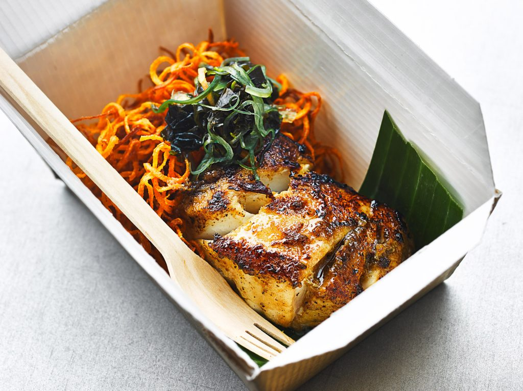 Photo of blackened Cod Fish in street food box