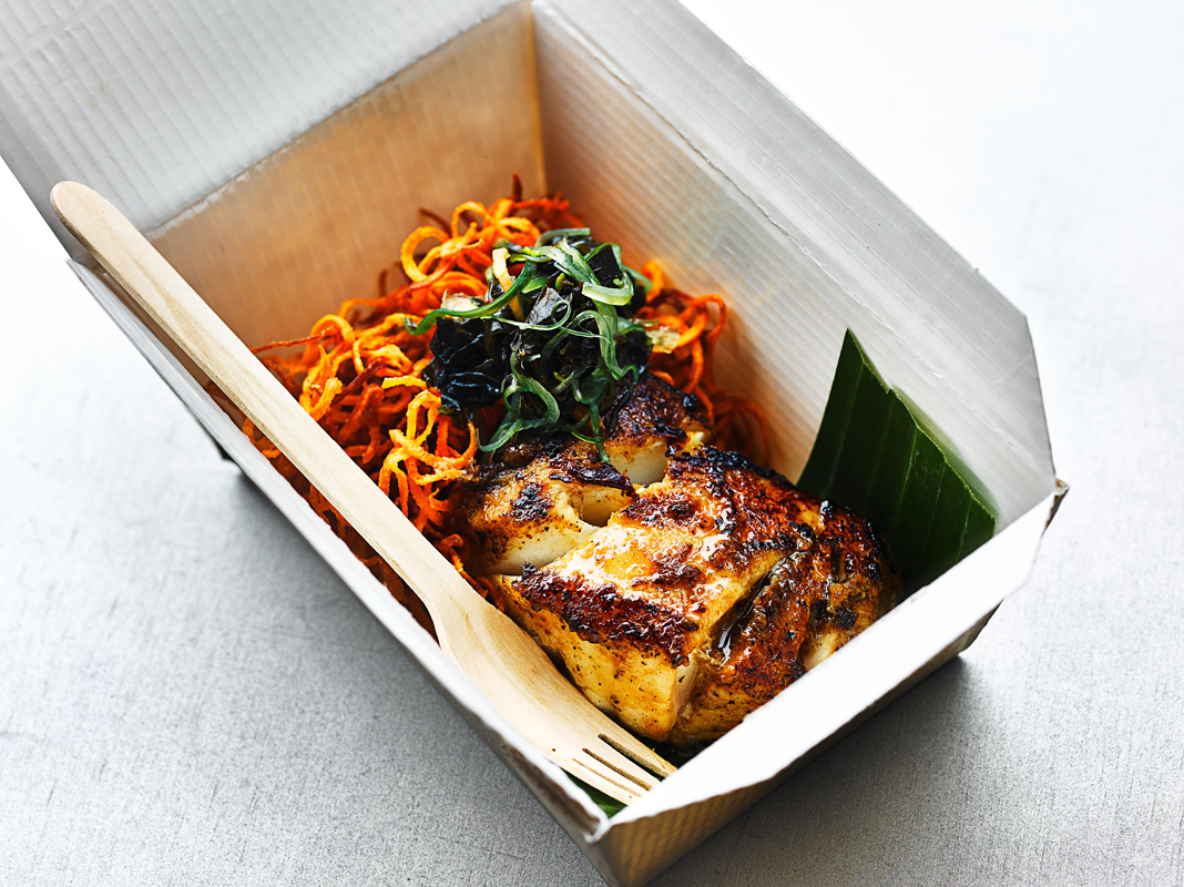 Blackened Cod in food box with wooden fork, street food sty;e by London food Photographer Michael MIchaels