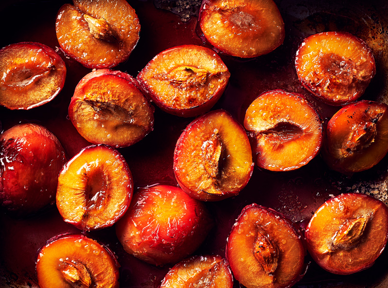 Baked Plums in tray by London food photographer Michael Michaels