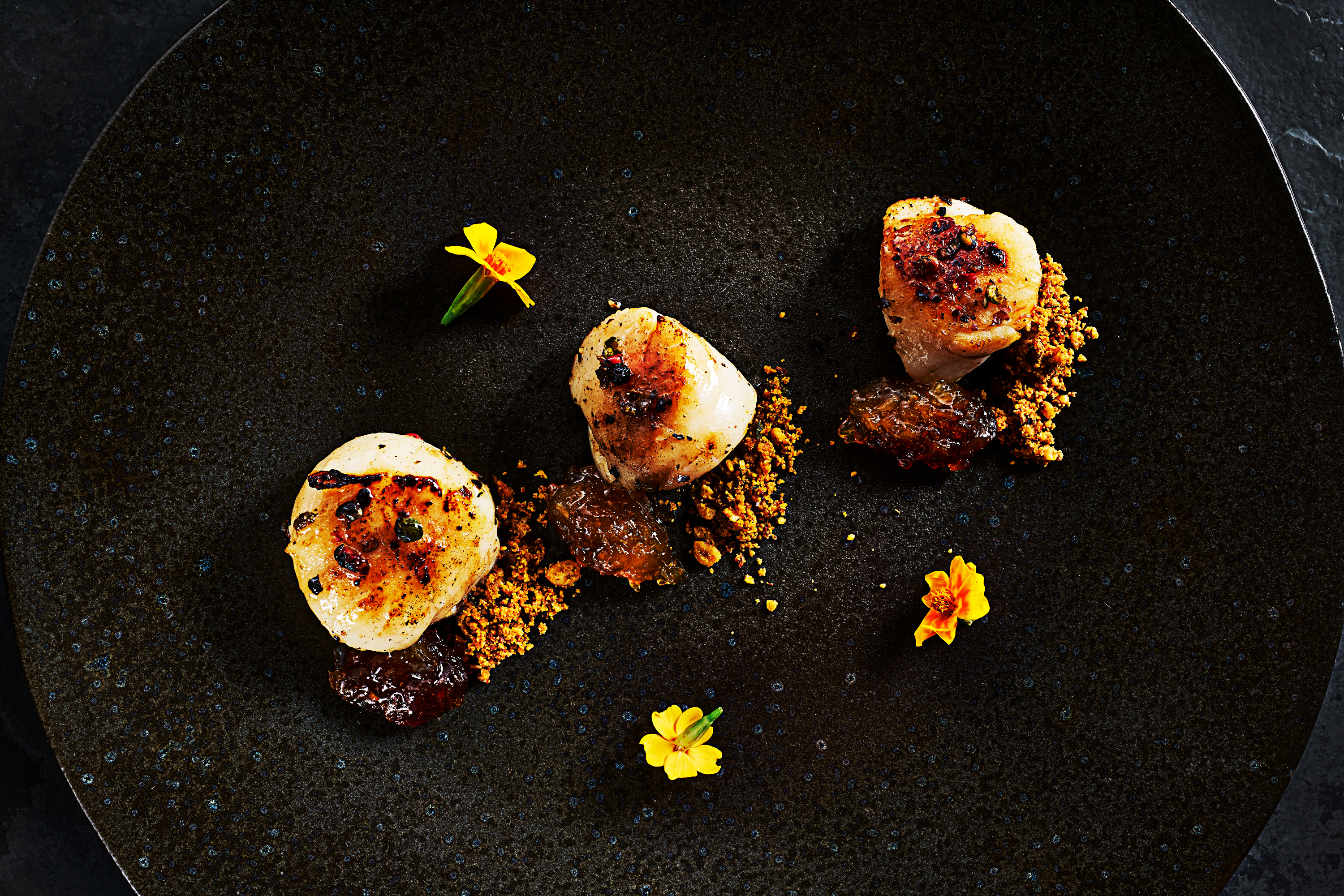 Photograph of Indian style scallops by London food photographer, Michael Michaels