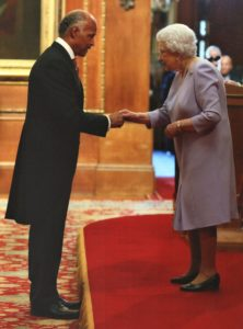 The Legendary, John Conteh receiving an OBE from the queen
