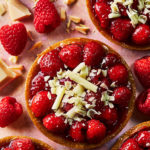 Photo of Raspberry Tart, overhead, with white chocolate shavings by London food photographer, Michael Michaels