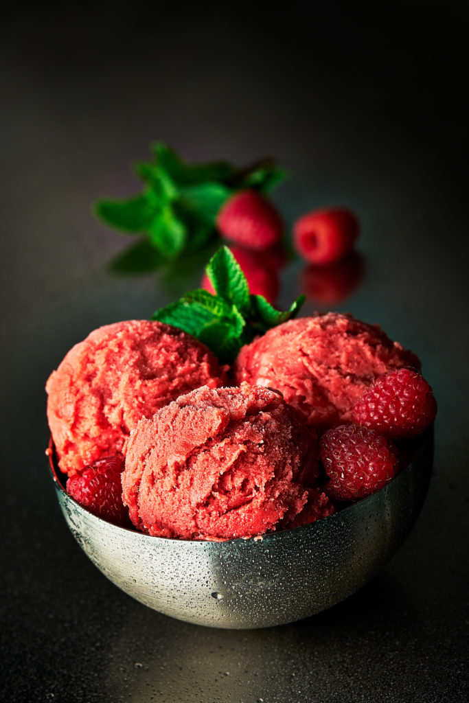 Photo of Raspberry Sorbet on dark stainless steel background