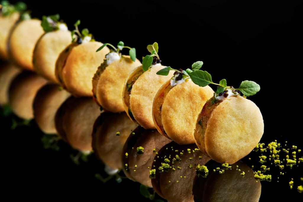 Moroccan chicken canapes on black perspex, by London food photographer